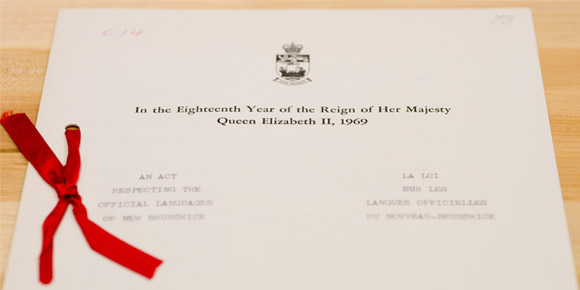 Document with seal, red ribbon bow, and heading In the Eighteenth Year of the Reign of Her Majesty Queen Elizabeth II, 1969.